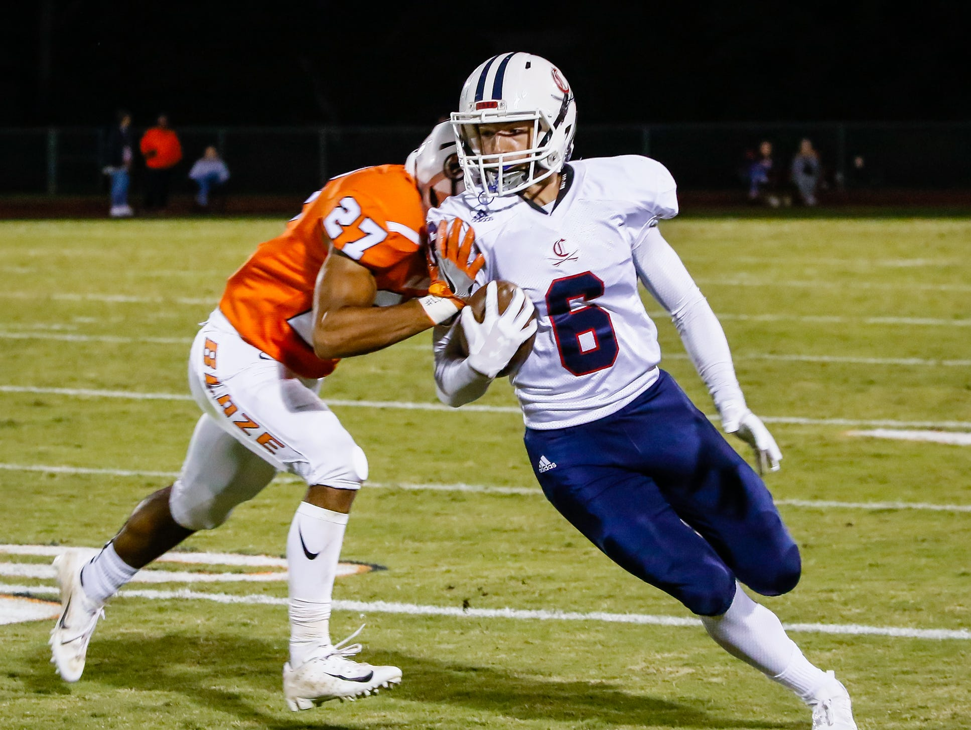 Owen Stockton pulls in a pass for Cookeville before being pushed out of bounds by Blackman's Jalen Brown.