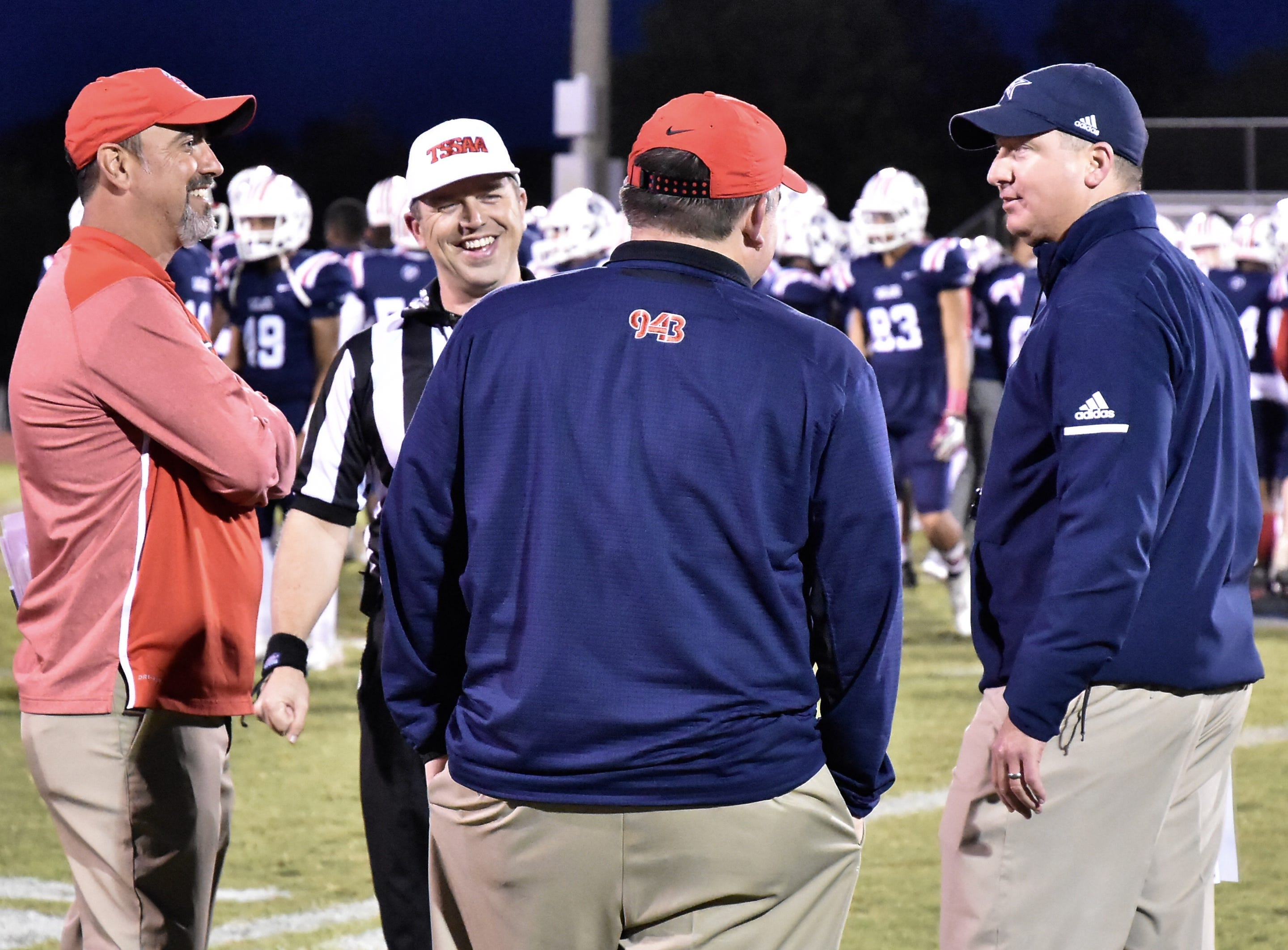 Oakland head coach Kevin Creasy and Siegel head coach Michael Copley talk with an official before the start of their game Friday night.