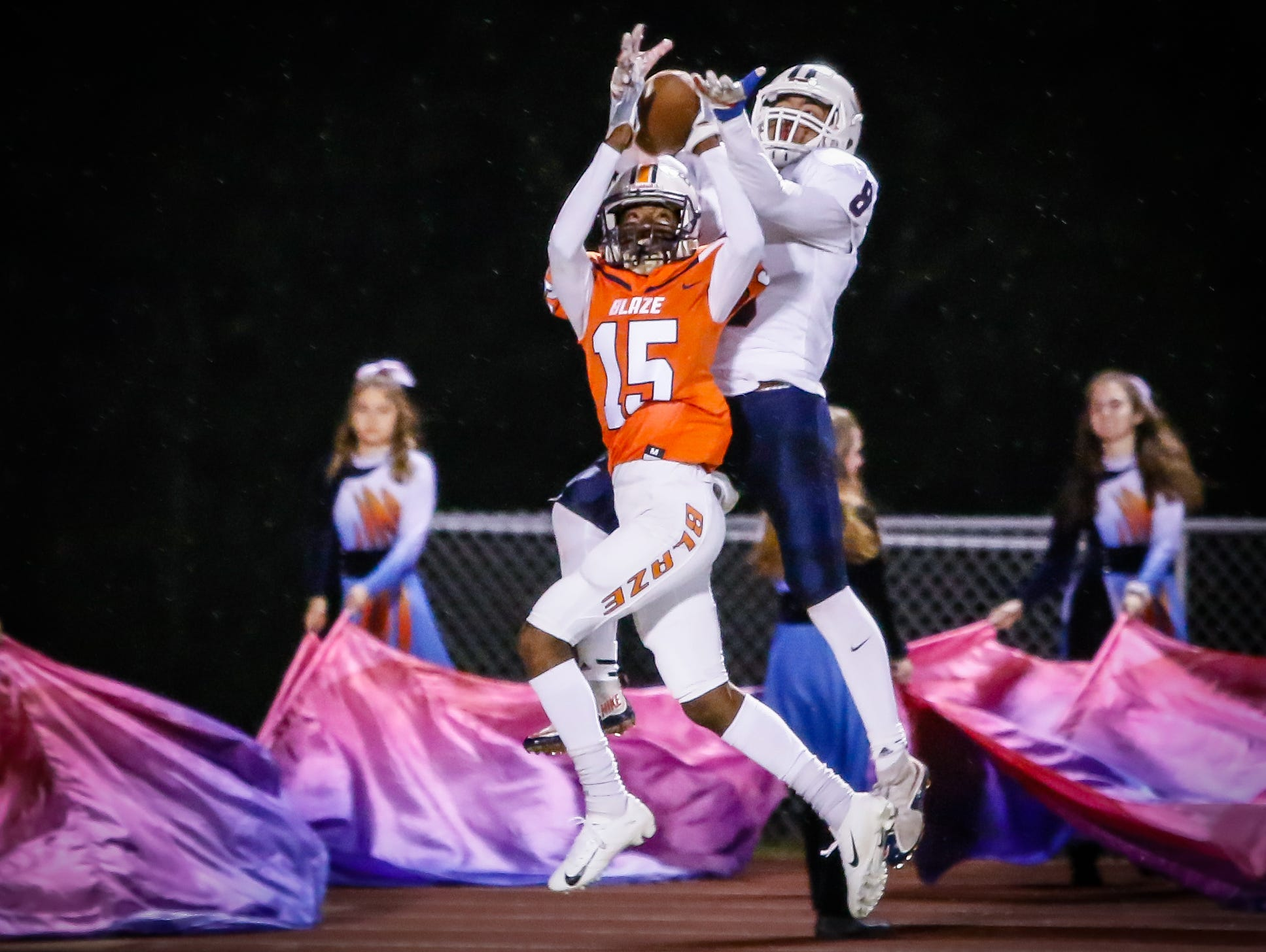 Blackman's Camden Williams and Cookeville's Brayden Nivens battle for a pass late in the first half.
