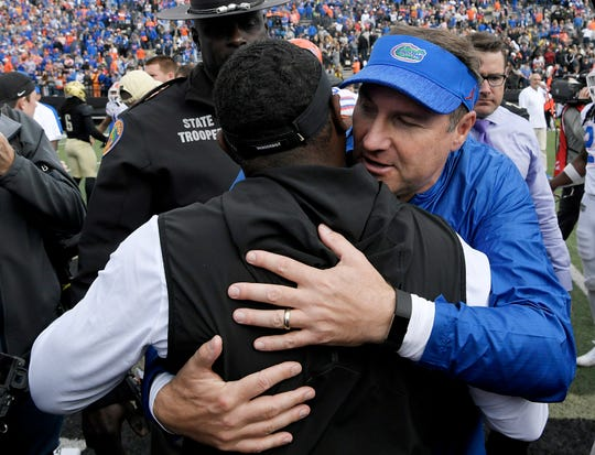 Florida head coach Dan Mullen embraces Vanderbilt head coach Derek Mason after a game at Vanderbilt Stadium in Nashville on Saturday, Oct. 13, 2018.