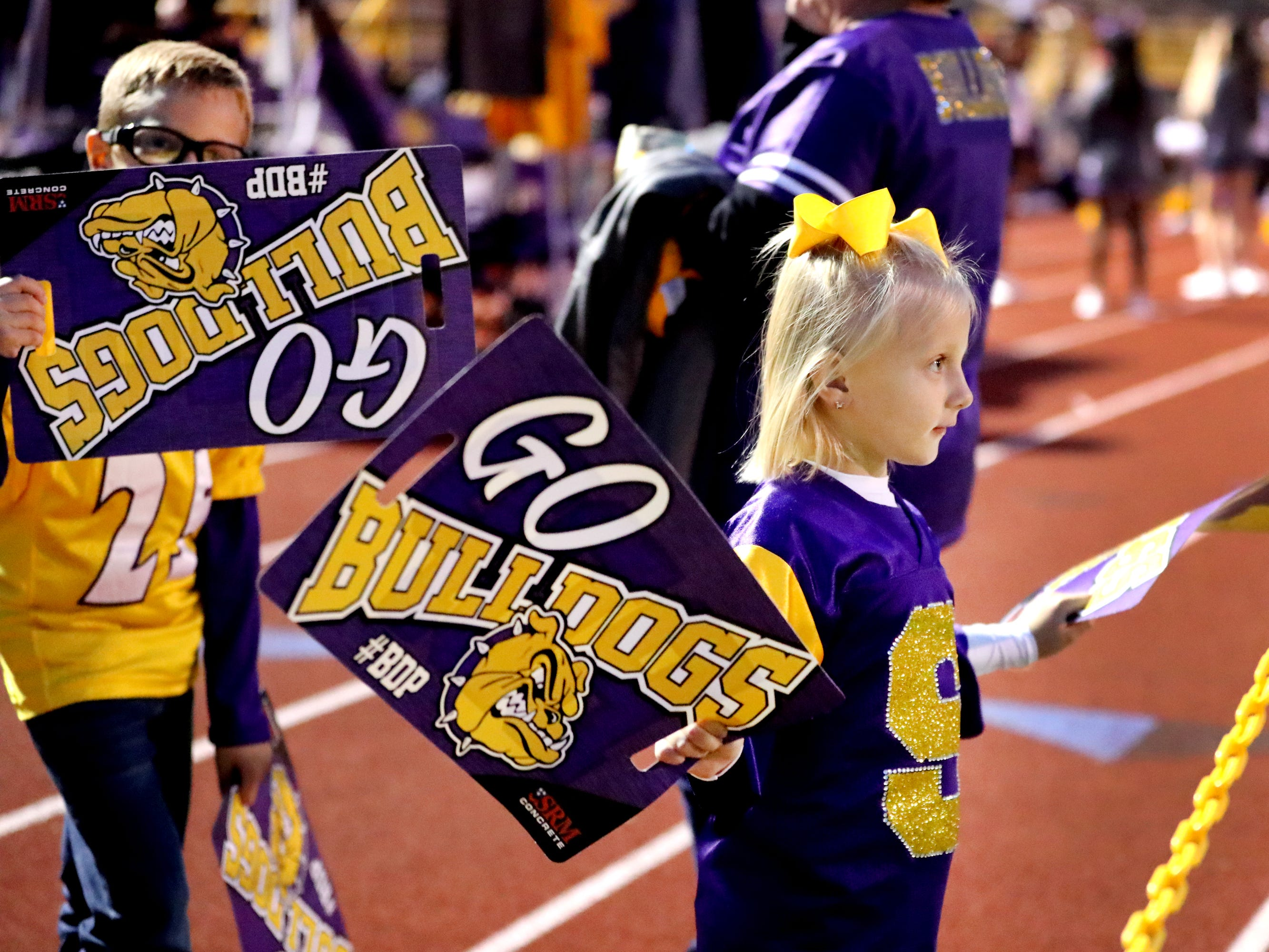 Smyrna fans Jayson Phillips, 7, and Emilee  Phillips, 5, get ready of the game against Stewarts Creek at Smyrna High School on Friday, Oct. 12, 2018, where their grandfather Dennis Johnson, will be honored during halftime.