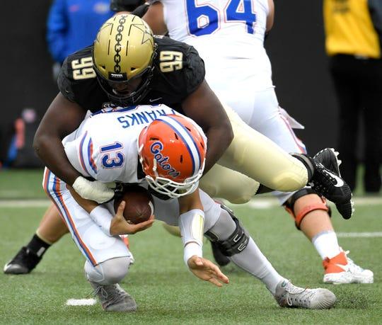 Florida Gators quarterback Feleipe Franks (13) is sacked by Vanderbilt Commodores defensive lineman Stone Edwards (99) during a game at Vanderbilt Stadium in Nashville on Saturday, Oct. 13, 2018.