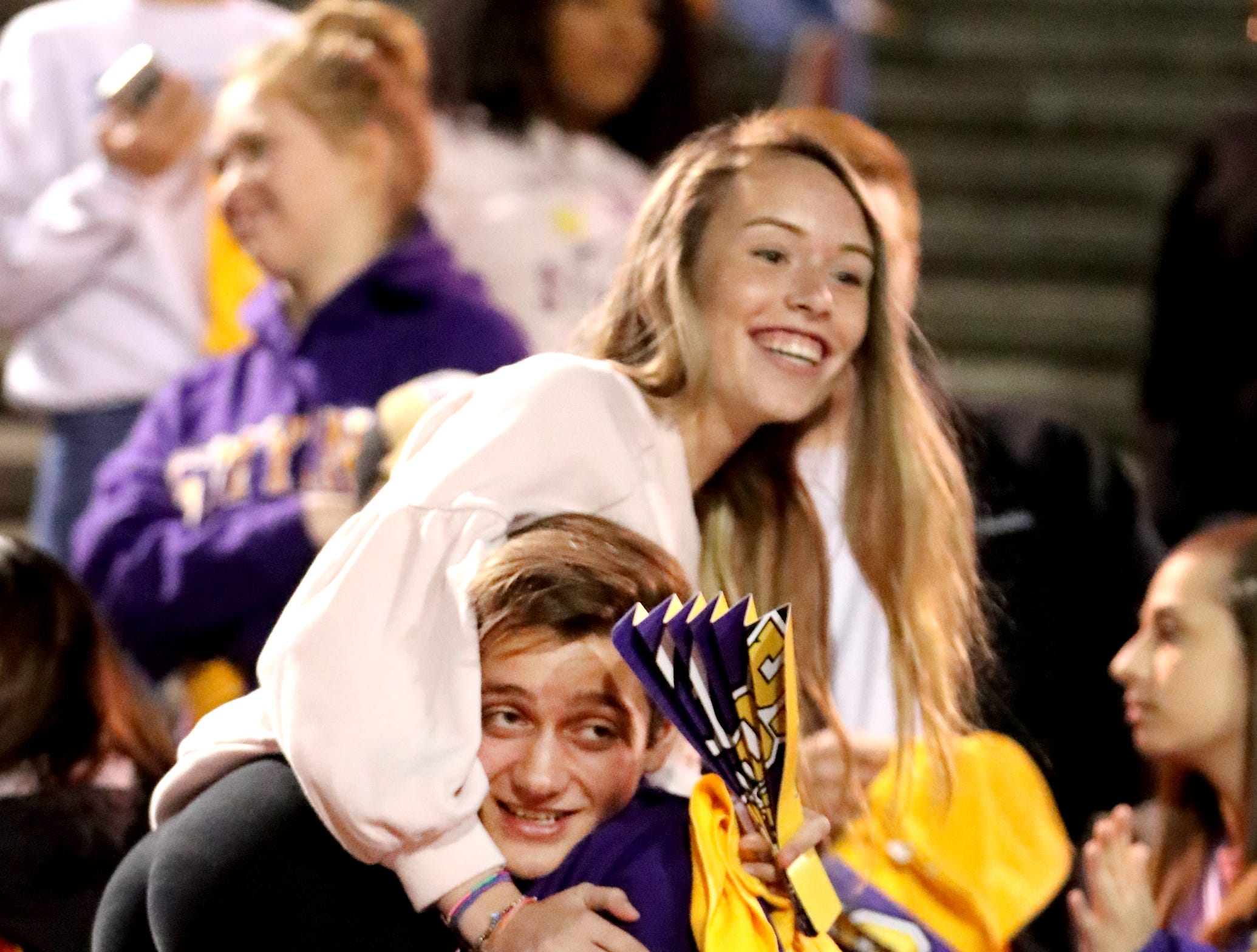 Smyrna seniors Elijah Moosekian, lifts up Lauren McMaken in the stands before the start of the game against Stewarts Creek at Smyrna High School on Friday, Oct. 12, 2018.