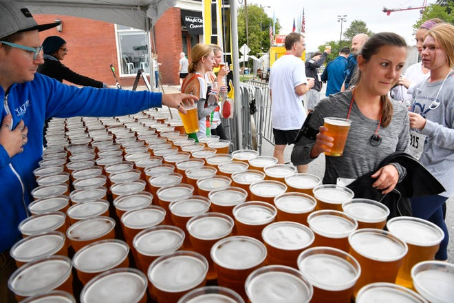 Runners grab a beer after the annual 5K Bier Run through the streets of Historic Germantown in downtown Nashville where runners get free 20 ounce beers at the end of the race.! Oktoberfest is Nashville's oldest & largest festival, and the 2nd largest Oktoberfest in the USA! Saturday Oct. 13, 2018, in Nashville, Tenn.
