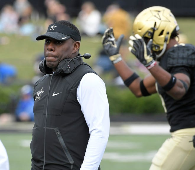 Vanderbilt coach Derek Mason walks