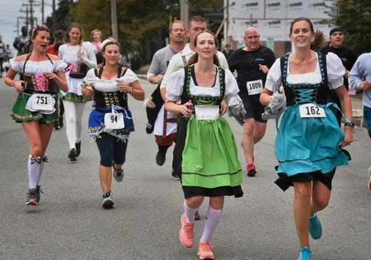 A few runners chose to dress for the annual 5K Bier Run through the streets of Historic Germantown in downtown Nashville where runners get free 20 ounce beers at the end of the race.! Oktoberfest is Nashville's oldest & largest festival, and the 2nd largest Oktoberfest in the USA!