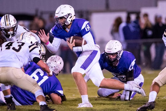 Portland's Caleb Mandrell (18) tries to find a hole during Portland's game against Springfield at Edgar Johnson Stadium in Portland on Friday, Oct. 12, 2018.