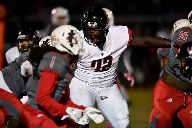 Pearl-Cohn Elijah Simmons (72) breaks through the East Nashville offensive line during their game at East Nashville High School Friday, Oct. 12, 2018, in Nashville, Tenn.