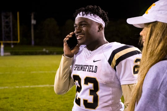 Springfield's Dayron Johnson (23) talks to his brother on the phone, which he does after every game, after Portland's game against Springfield at Edgar Johnson Stadium in Portland on Friday, Oct. 12, 2018.