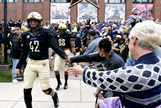 Vanderbilt fans cheer on players during the Star Walk before the Florida game at Vanderbilt Stadium in Nashville on Saturday, Oct. 13, 2018.