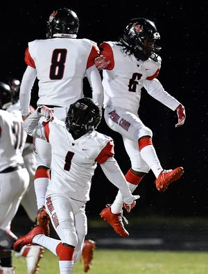 Pearl Cohn's Xavier Sheperd (8) and Kwame Hayes (6) celebrate their touchdown of the opening kickoff against East Nashville at East Nashville Magnet High School Friday, Oct. 12, 2018, in Nashville, Tenn.