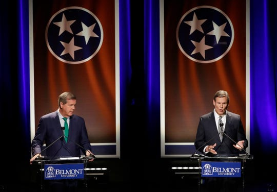 Republican businessman Bill Lee, right, answers a question during the final gubernatorial debate with Democratic former Nashville Mayor Karl Dean, left, at Belmont University on Oct. 12, 2018, in Nashville.