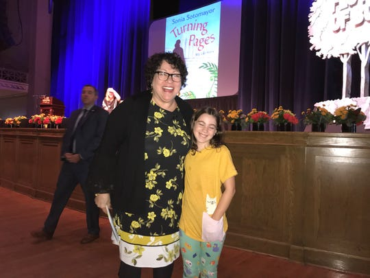 Supreme Court Justice Sonia Sotomayor hugged 10-year-old Eliza Bell during a question-and-answer period of her presentation at War Memorial Auditorium on Saturday.