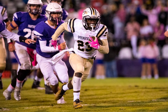 Springfield's Dayron Johnson (23) runs on the way to a touchdown during Portland's game against Springfield at Edgar Johnson Stadium in Portland on Friday, Oct. 12, 2018.