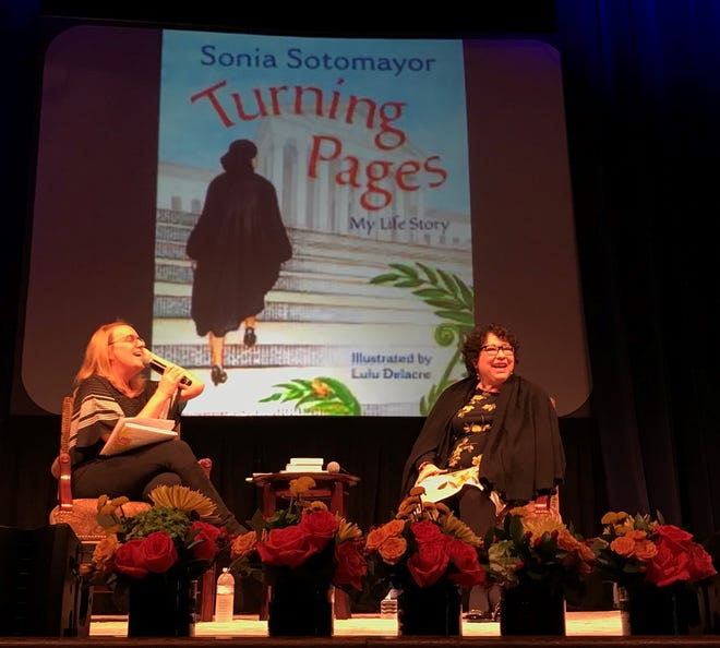 Supreme Court Justice Sonia Sotomayor discusses her new children's book with blogger Julie Danielson at War Memorial Auditorium on Saturday.