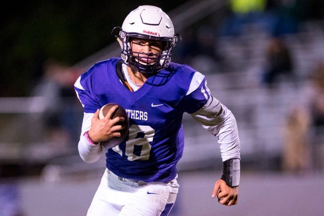 Portland's Caleb Mandrell (18) runs the ball during Portland's game against Springfield at Edgar Johnson Stadium in Portland on Friday, Oct. 12, 2018.