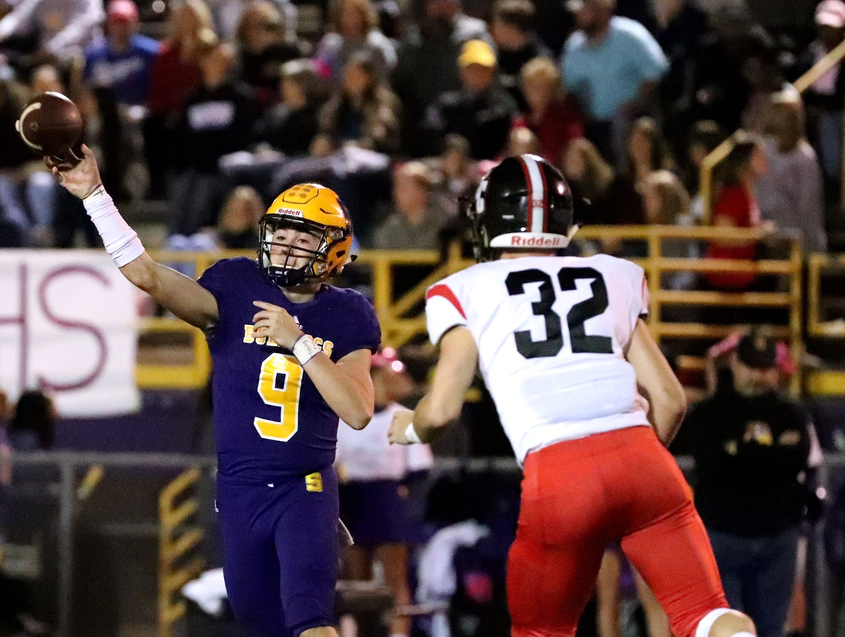 Smyrna's quarterback Alex Bannister (9) passes the ball as Stewarts Creek's Aaron Snowden (32) puts on the pressure  at Smyrna High School on Friday, Oct. 12, 2018.
