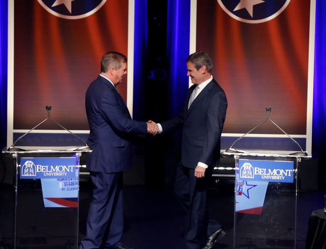 Tennessee gubernatorial candidates Karl Dean, left, and Bill Lee take the stage at Belmont's Troutt Theater for their final debate Oct. 12, 2018.