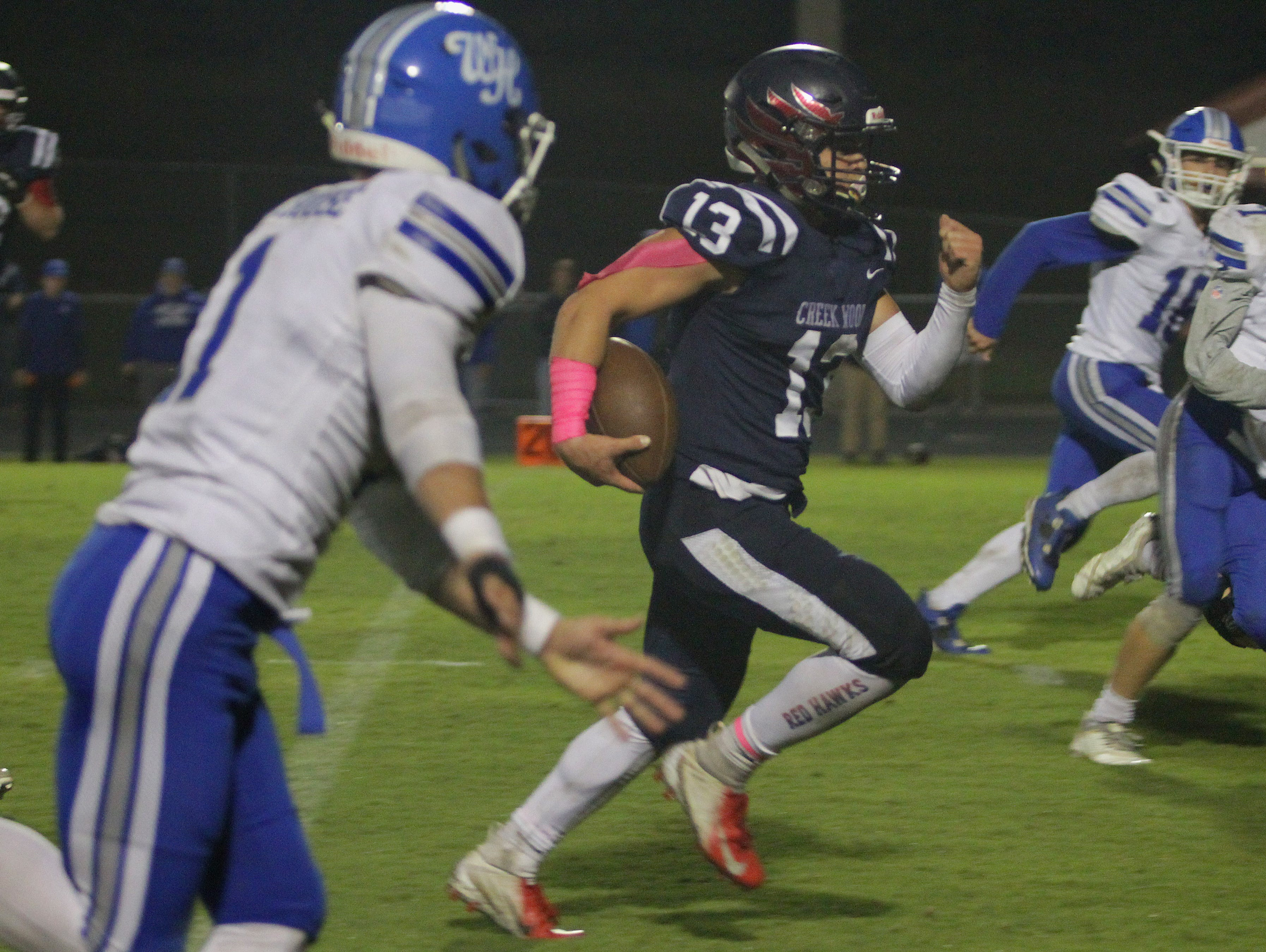 Creek Wood's Sam Askins out runs the White House Defense to score a TD on Friday, October 12, 2018.
