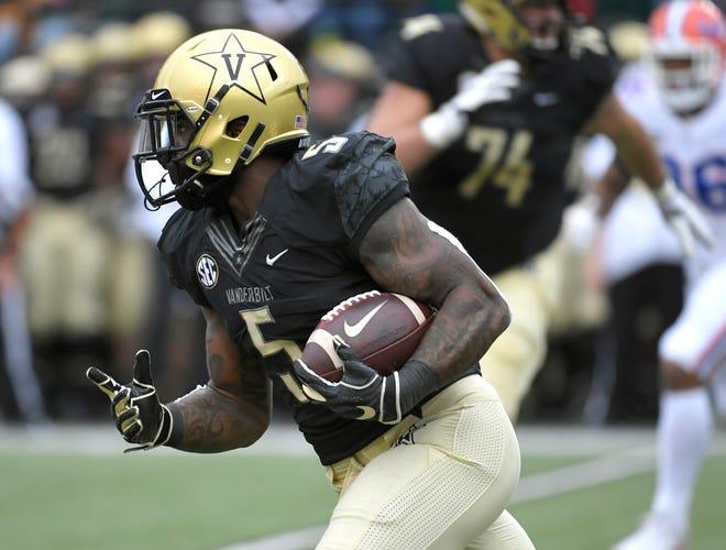 Vanderbilt running back Ke'Shawn Vaughn scores a touchdown against Florida on Saturday.