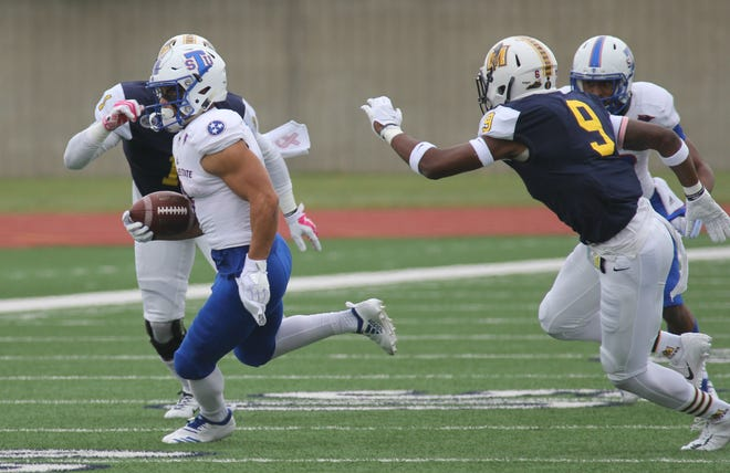 Tennessee State receiver Chris Rowland tries to elude two Murray State defenders in Saturday's game.