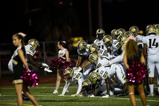 Golden Gate's football team gets hyped up before a game against Naples High School in Naples, Fla., on Friday, October 12, 2018.