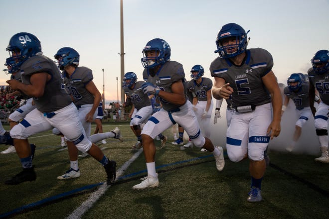 Barron Collier, shown during a game against Palmetto Ridge, has won six straight entering Friday's game at Naples for the Class 6A-District 12 championship. The Cougars still have a bitter taste in their mouths from last year's last-minute loss to Naples.