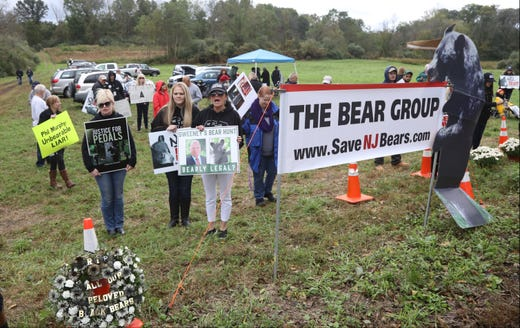 Protesters stage across the road from a NJ Fish and Wildlife Station where hunters are to bring their the bears they killed. As of 3pm there where no bears registered at this station.