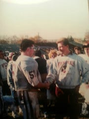 Lou Brandt (left) talking to former head coach Chris Olsen during his playing days at Wayne Hills.