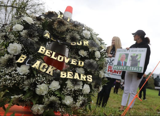 Protesters place a wreath across the street from a NJ Fish and Wildlife registration station where dead bears are to be brought in by hunters.