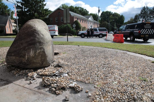 A large boulder was upended and pushed forward in front of the Camp Merritt Memorial Monument in Cresskill.