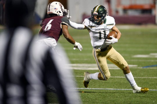 St. Joseph at Don Bosco on Friday, October 12, 2018. SJ #11 Brett Buckman fights off a tackle in the first quarter.