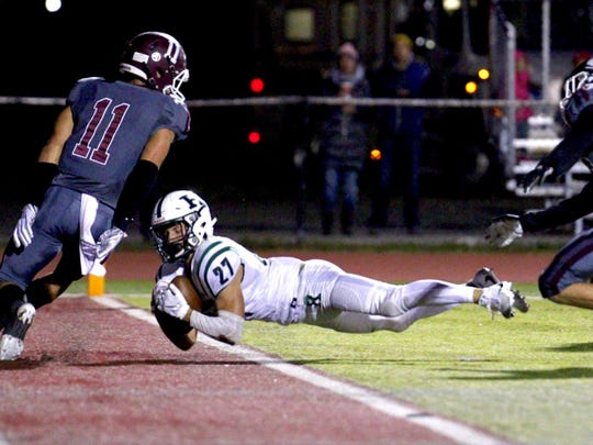 Ramapo's Max Baker dives into the end zone against Wayne Hills on Friday, Oct. 12.