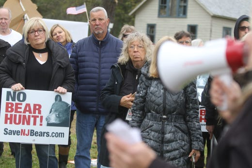 Protesters gather before breaking up and ending their protest of the bear hunt.