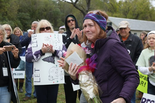 Angi Metler, Executive Director of the Animal Protection League of New Jersey is overcome with emotion as she is honored and thanked by her group of anti bear hunt protesters for being instrumental in organizing the protest.