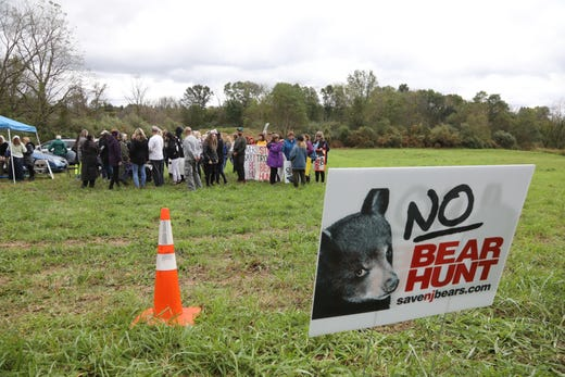 The group of protesters gather to end their protest of the six day bear hunt.