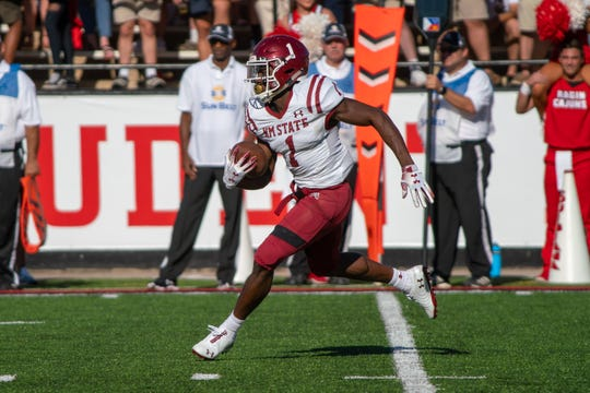 New Mexico State's Jason Huntley moves the ball down the field as the New Mexico State Aggies take on the UL Lafayette Ragin' Cajuns at Cajun Field on October 13, 2018.