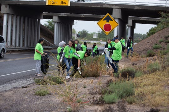 Members of Girl Scout Troop 62578 team up with HOSA, Health Occupation Student Association at Arrowhead Park Early College School to pickup trash along Cholla Dr. The city wide Toss No Mass cleanup event was held on Saturday, October 13, 2018.