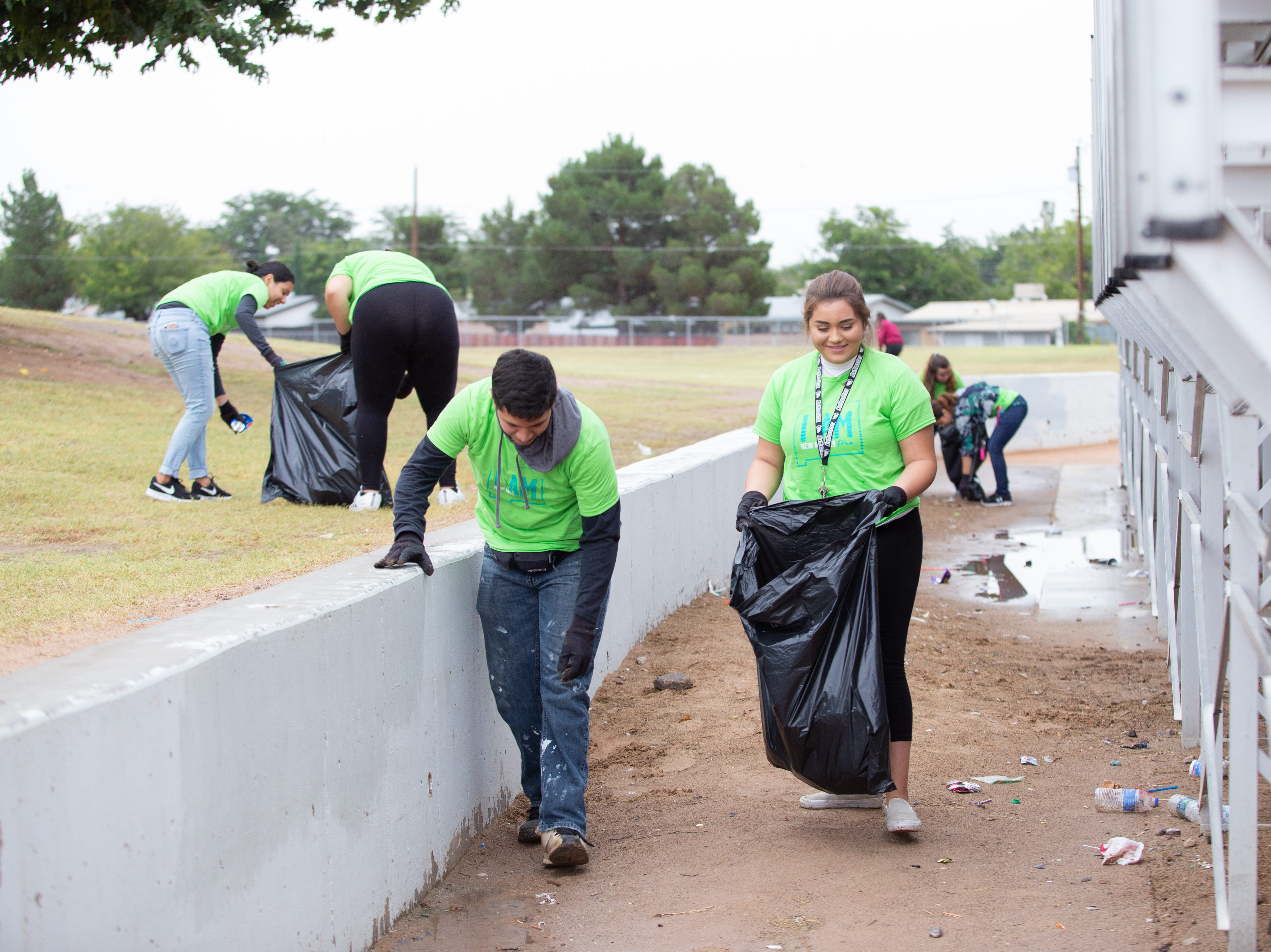 ASNMSU students Gabriel Ronquillo and Chloe Jimenez pickup trash during the city wide cleanup event  held on Saturday, October 13, 2018.