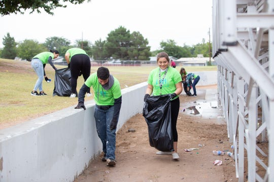 ASNMSU students Gabriel Ronquillo and Chloe Jimenez pick up trash during the citywide cleanup event held on Saturday, October 13, 2018.