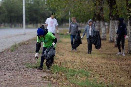 Americorp and FYI member Bethany Brandt and members of the NMSU Government Graduate Students beautifying the landscape during the Toss No Mass cleanup event held on Saturday, October 13, 2018.