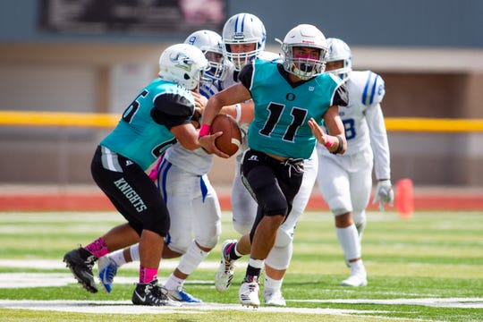 Oñate's Jaden Diaz runs back an interception against Carlsbad Saturday at the Field of Dreams.