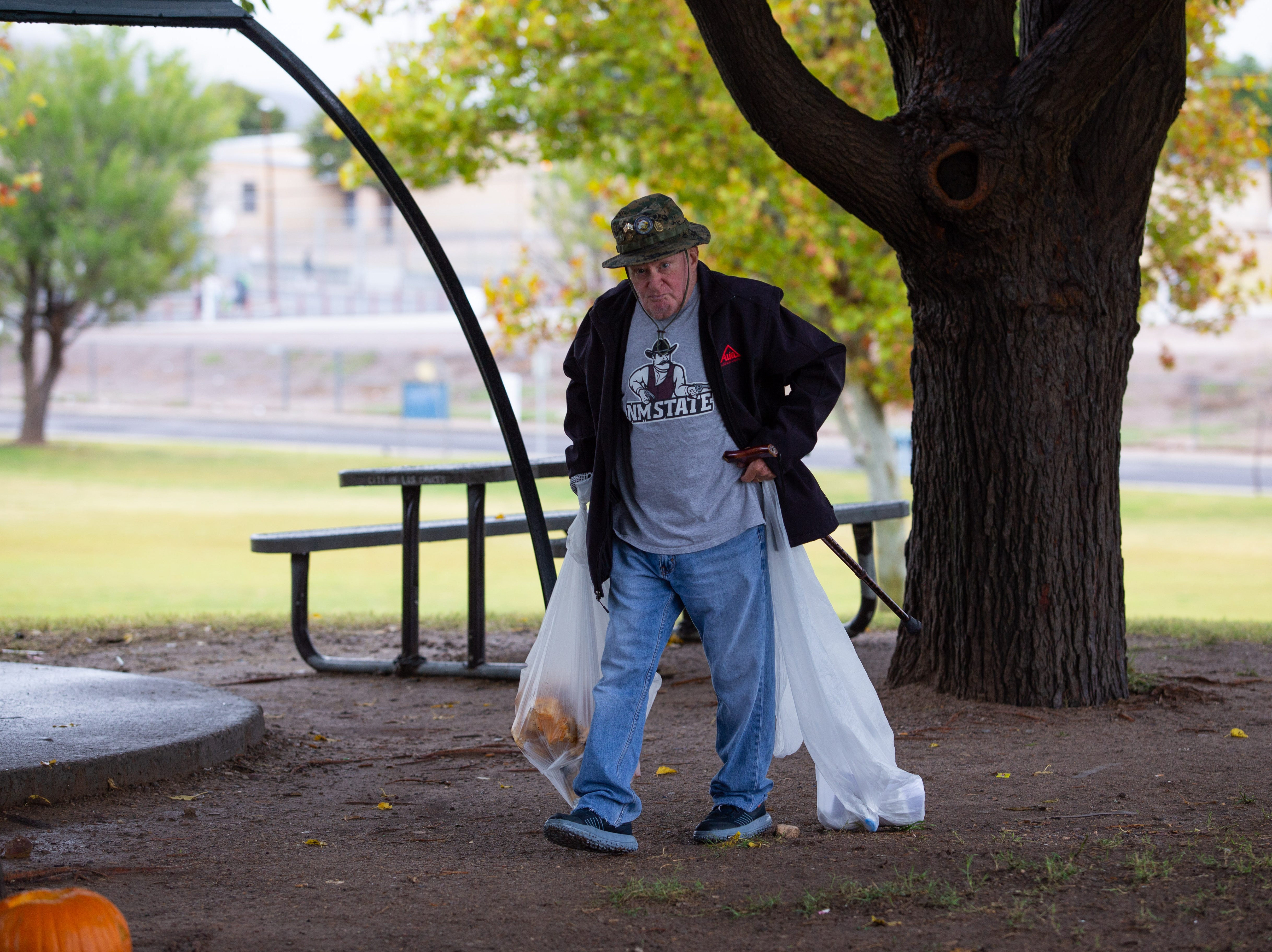 Vietnam veteran Marshal Ludwig participates in Toss No Mas at Young Park. The citywide cleanup event was held on Saturday, October 13, 2018.
