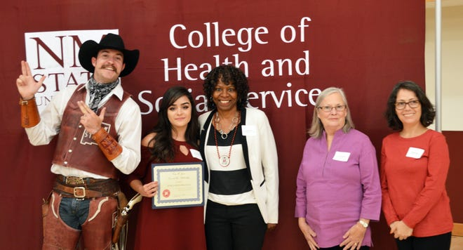 NMSU Assistant Vice President for Human Resource Services Gena Jones, center, recently started a scholarship in the College of Health and Social Services where she graduated in 1981. During Homecoming weekend, Jones met one of the first recipients of her scholarship, Karla Solis-Holguin, second from left. They are joined by Pistol Pete and, from right, NMSU CHSS Dean Donna Wagner and Associate Professor of Social Work Maria Gurrola.