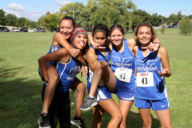 The Cavegirls varsity team of Alexis Villa, Shelby See, Isabel Franco, Marily Ortega and Cora Begay  pose following  Saturday's race in Roswell. All five Cavegirls finished in the top-25 and the team won the race.