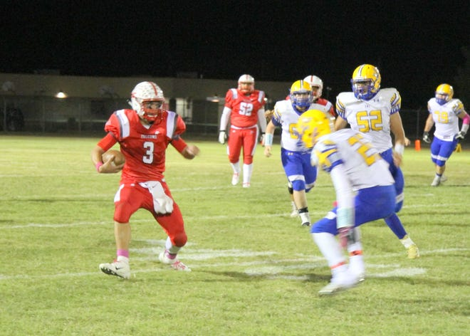 Loving quarterback Kevin Gut-omen scrambles for yardage during the first half of Friday's district game against Jal. The Jal Panthers won, 56-8.