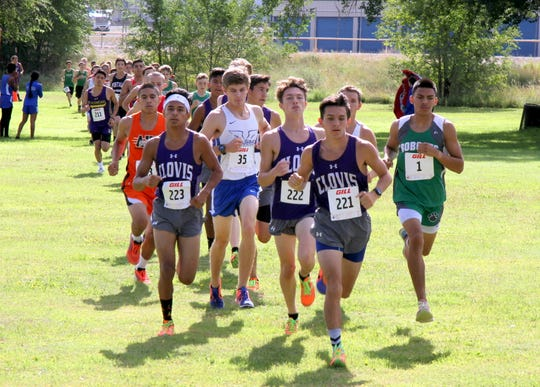 Carlsbad's Kevin Calvani (35) runs in the front-runner back during Saturday's race in Roswell. He finished in sixth place and the Cavemen took second place.
