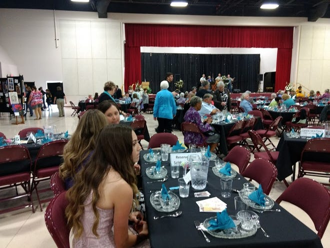 In this 2015 file photo, guests start to arrive at the 15th Annual Turquoise and Silver Tea while the group Simple Gifts plays opening music on the stage.