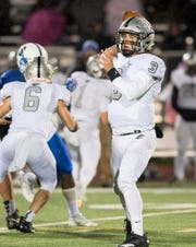 Plymouth quarterback Nick Downs threw for a pair of TDs in the Wildcats' 35-13 win over Salem.