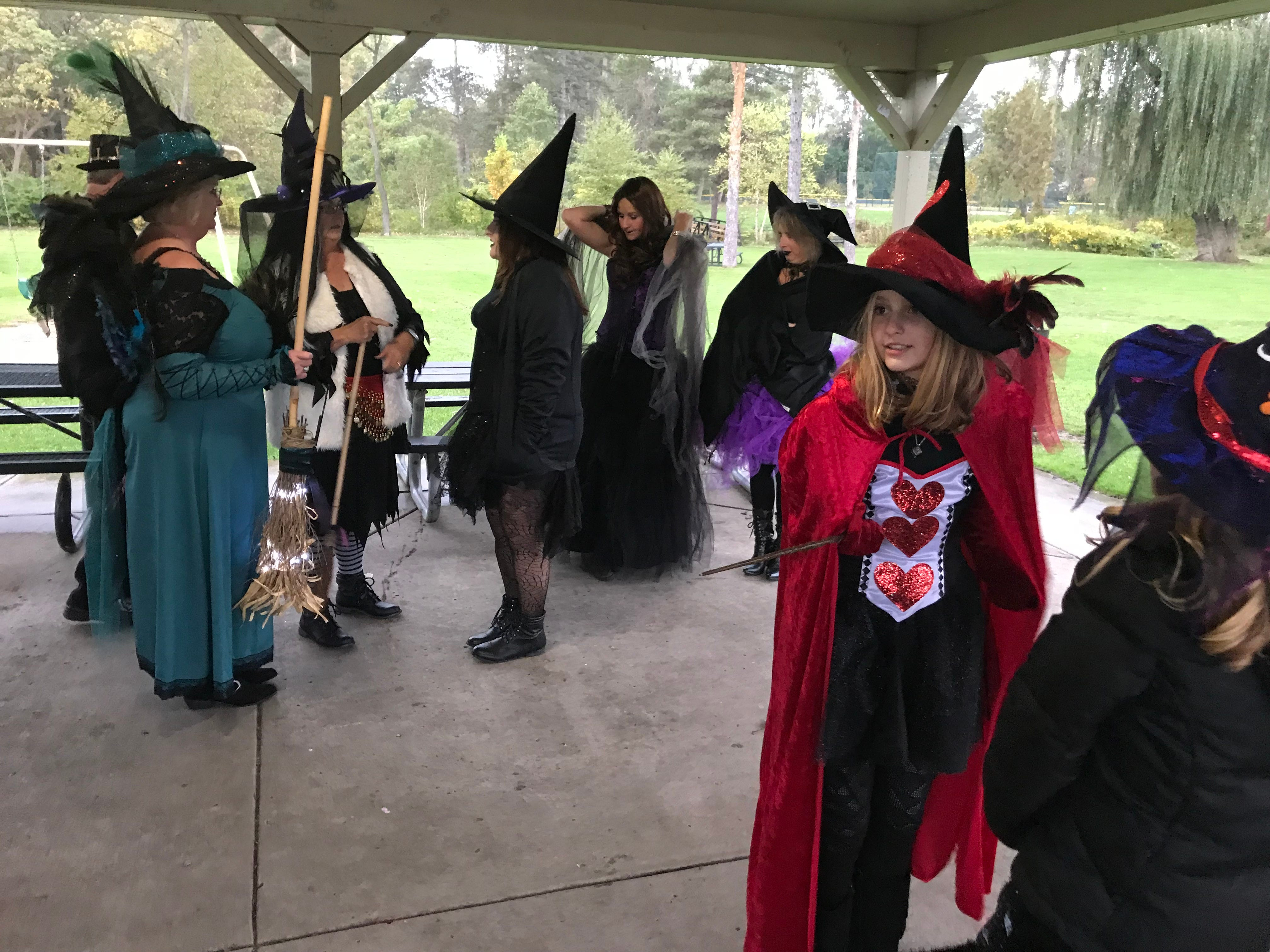 The witches gather in cold temps and with rain falling.